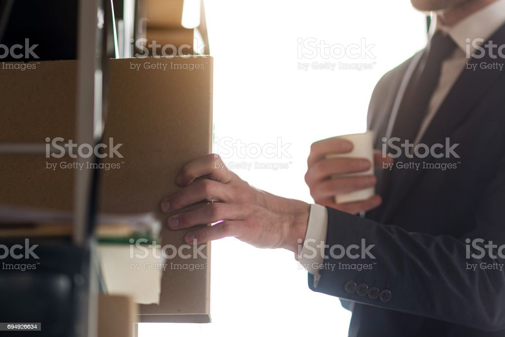 Young businessman is working with papers stock photo