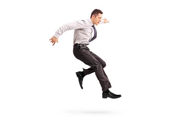 giovane uomo d'affari di saltare in aria - levitazione foto e immagini stock