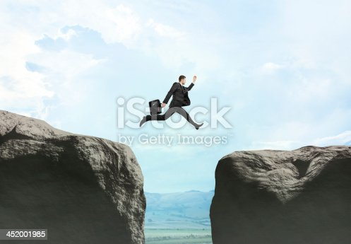 istock young businessman jumping 452001985