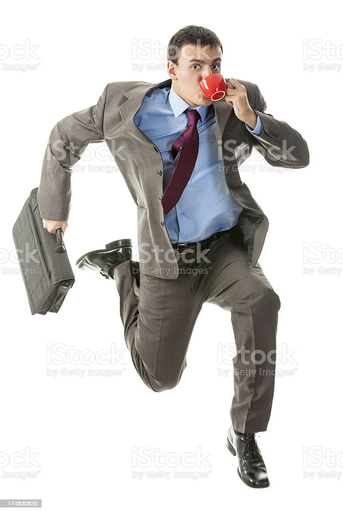 Young businessman late for work stock photo