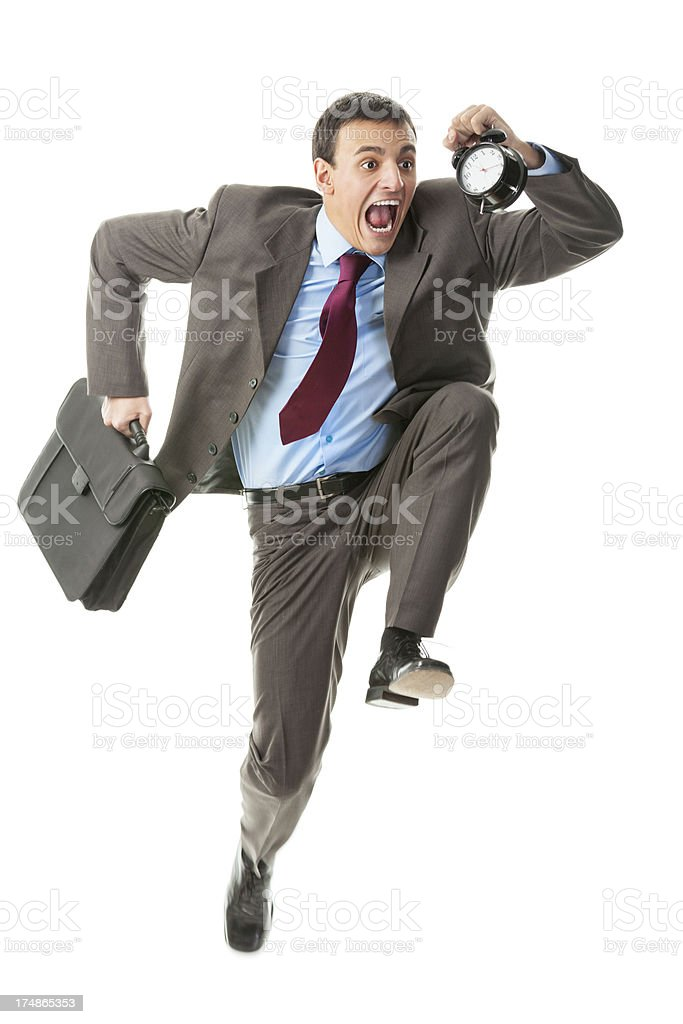 Young businessman late for work royalty-free stock photo