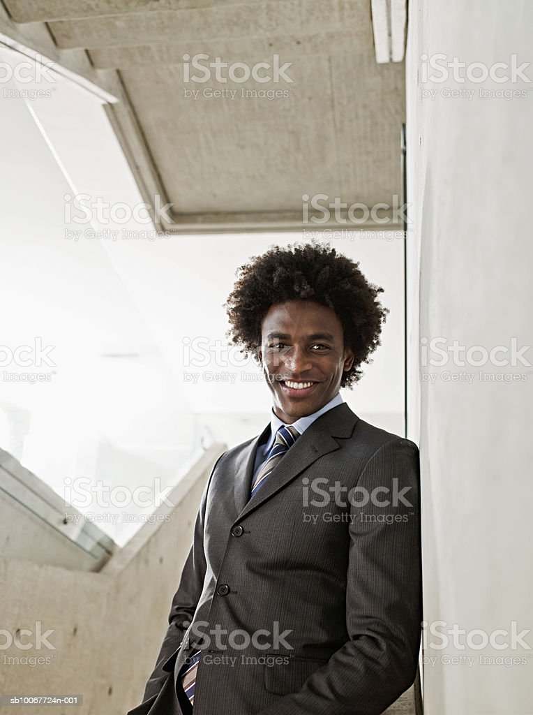 Young businessman leaning on stairs, portrait royalty-free stock photo
