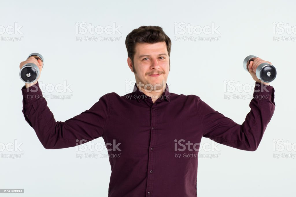 Young businessman lifting dumbbells royalty-free stock photo
