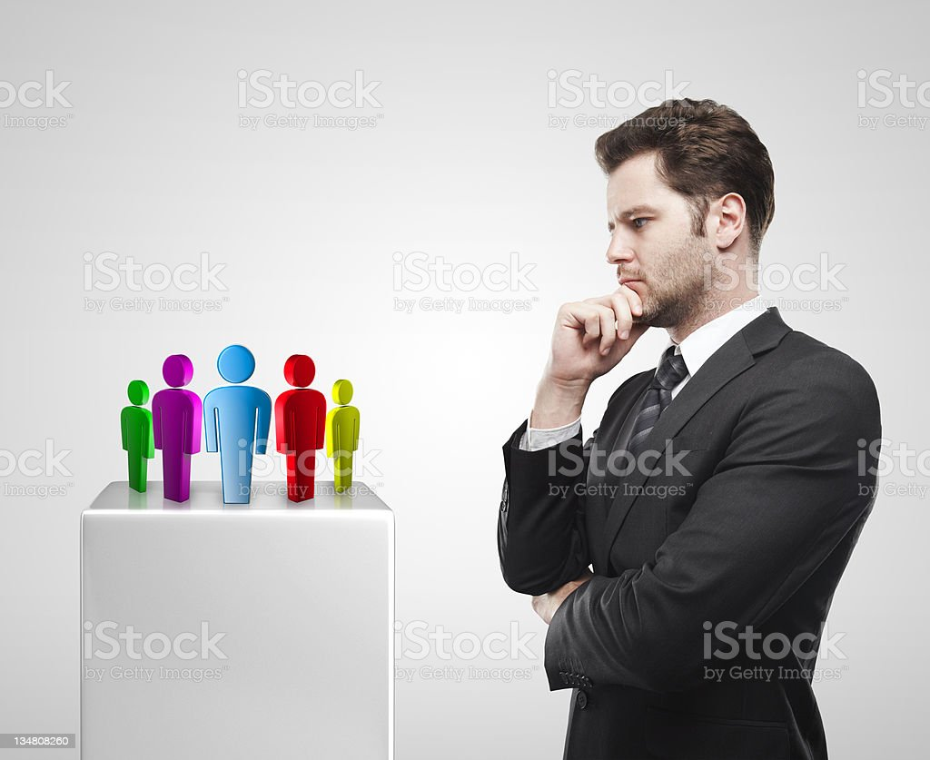 Young  businessman look at the group of social people royalty-free stock photo