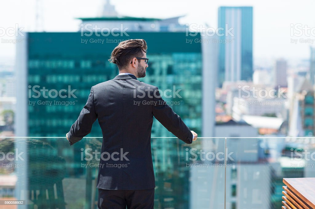 Young Businessman Looking at City stock photo
