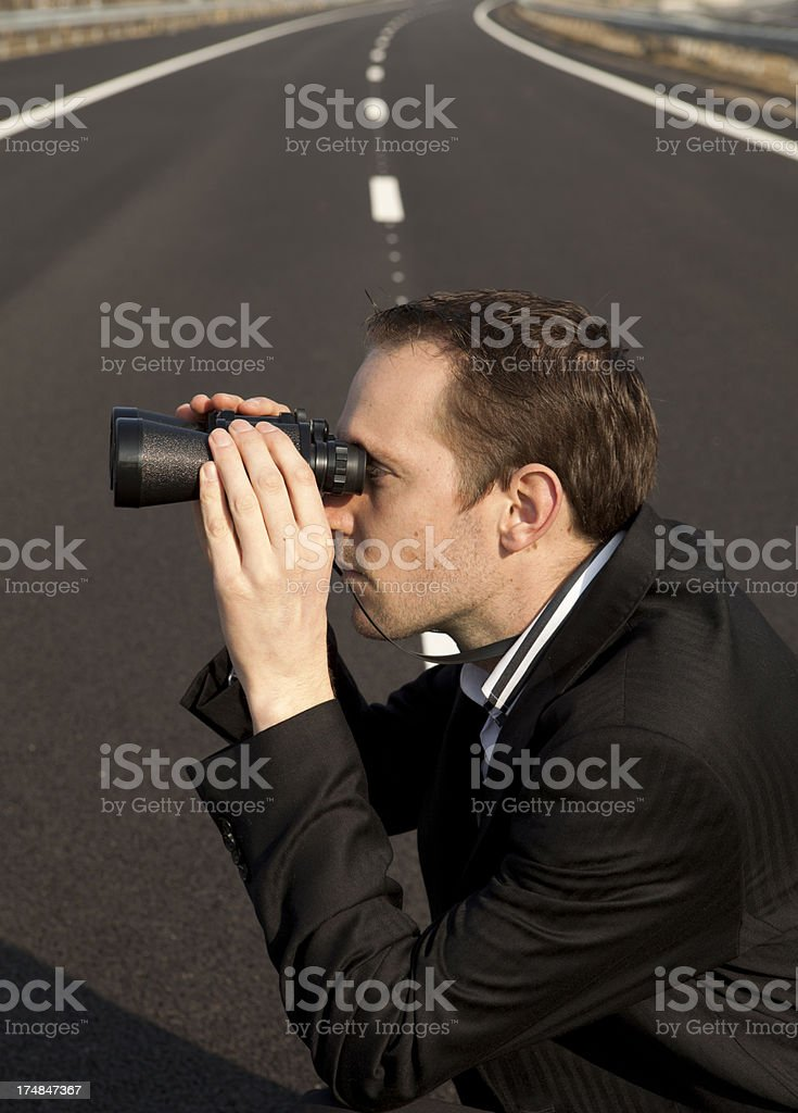 Young businessman looking for new opportunities royalty-free stock photo