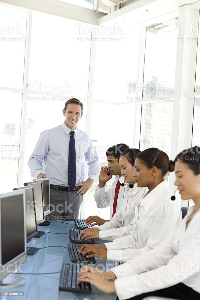Young businessman managing a call center team royalty-free stock photo