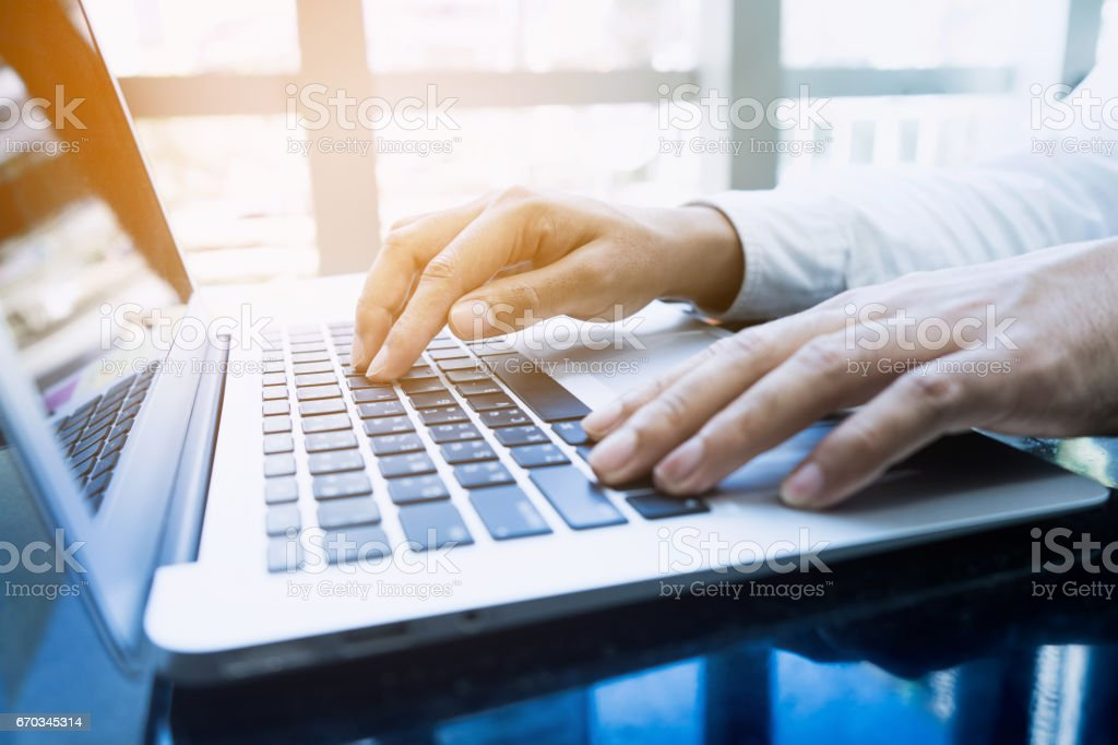 Young businessman multitasking using laptop.Business technology stock photo