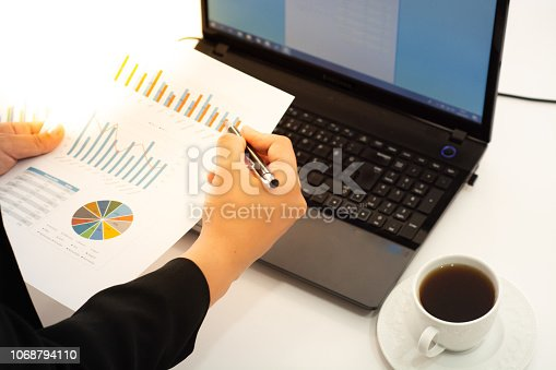 801895196 istock photo Young businessman multitasking using laptop.working concepts 1068794110