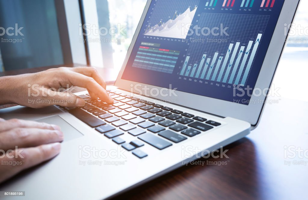 Young businessman multitasking using laptop.working concepts stock photo