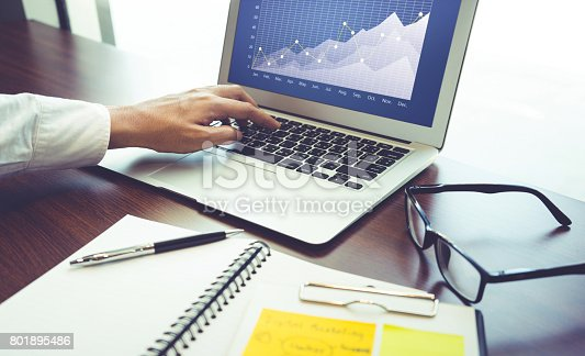 801895196 istock photo Young businessman multitasking using laptop.working concepts 801895486