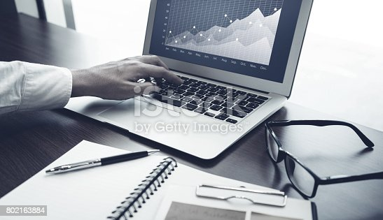 801895196 istock photo Young businessman multitasking using laptop.working concepts 802163884