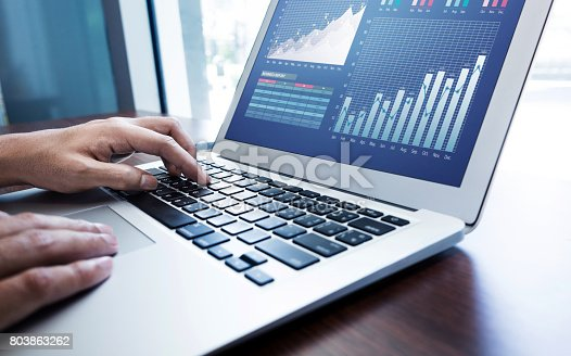 istock Young businessman multitasking using laptop.working concepts 803863262
