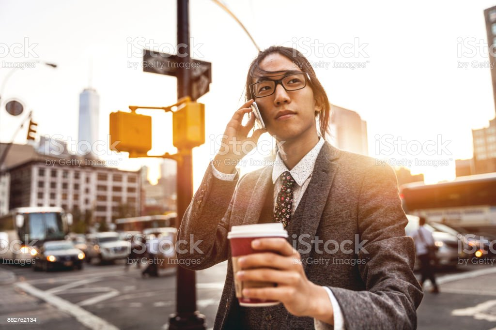 Young businessman on mobile in Soho New York stock photo
