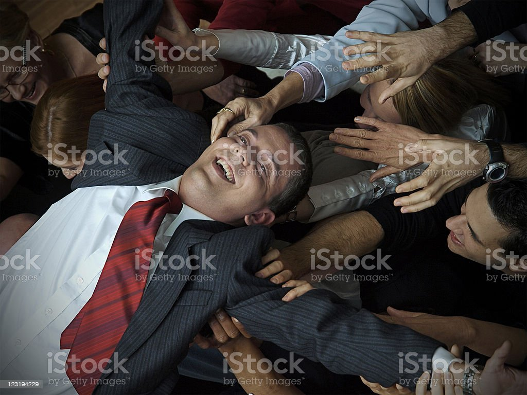 Young businessman on the hands of his colleges royalty-free stock photo