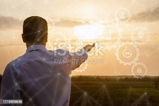 istock Young businessman operates a business management mechanism . 1219958648