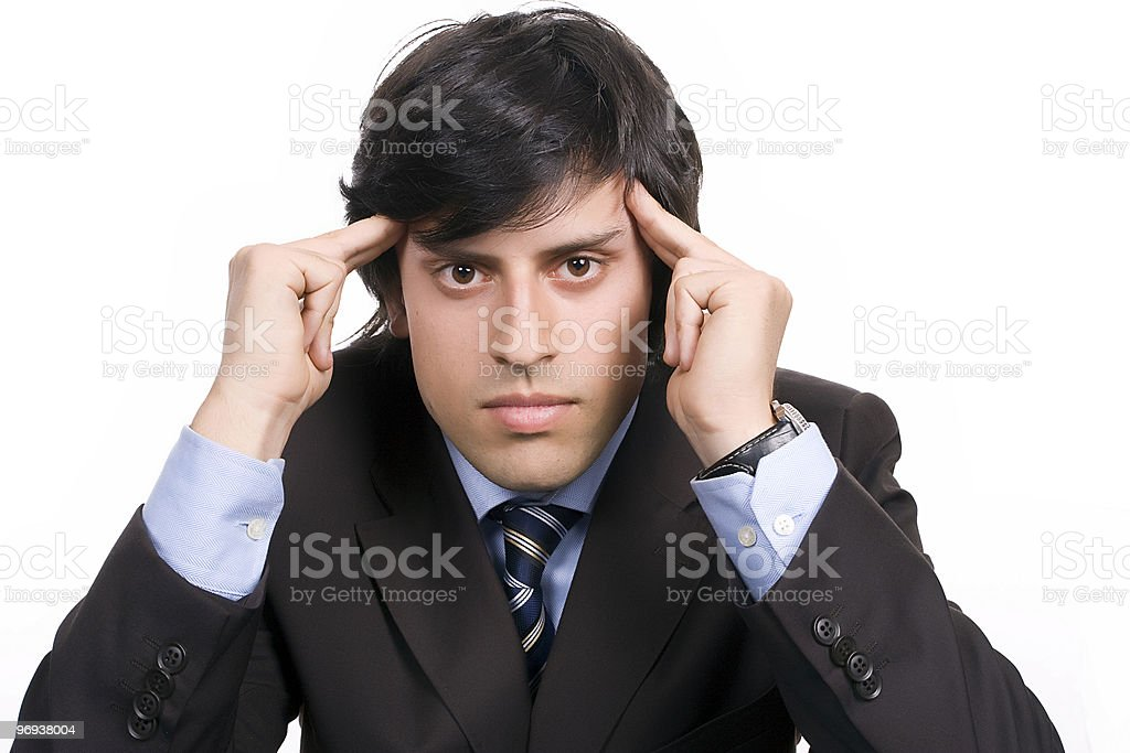 Young Businessman over a desk, full of thoughts royalty-free stock photo