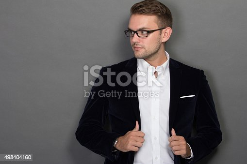 498403166 istock photo Young businessman posing chic in work suit and glasses 498404160