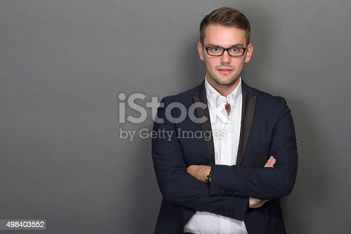istock Young businessman posing chic with glasses on 498403552