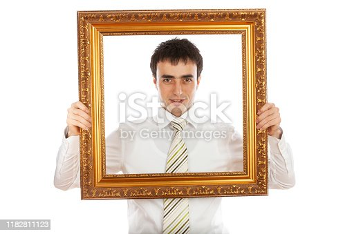 Young Businessman Posing From Behind The Picture Frame