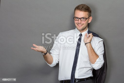 498403166 istock photo Young businessman presenting to copyspace 498401116