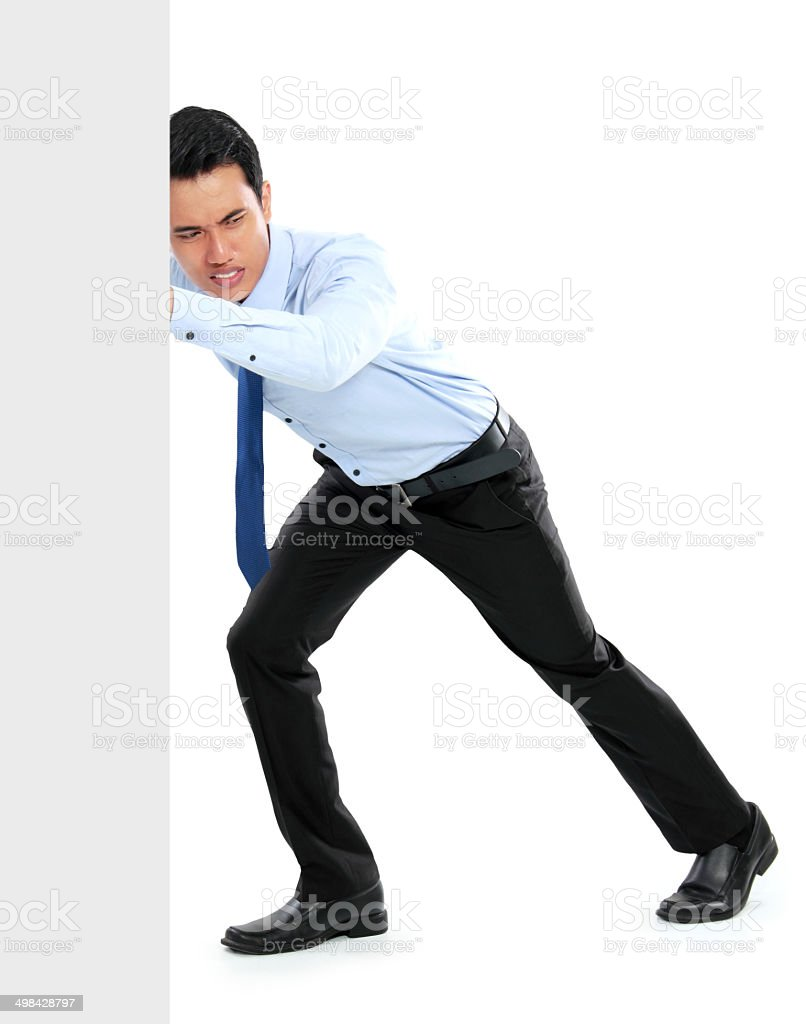Young businessman pushing a blank board stock photo