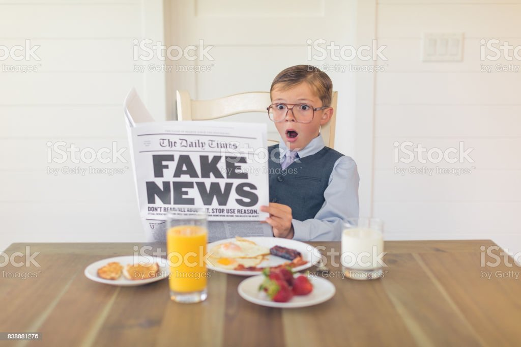 A Young Businessman Reading Fake News is Shocked stock photo