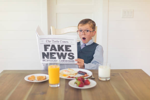 a young businessman reading fake news is shocked - imitation stock photos and pictures