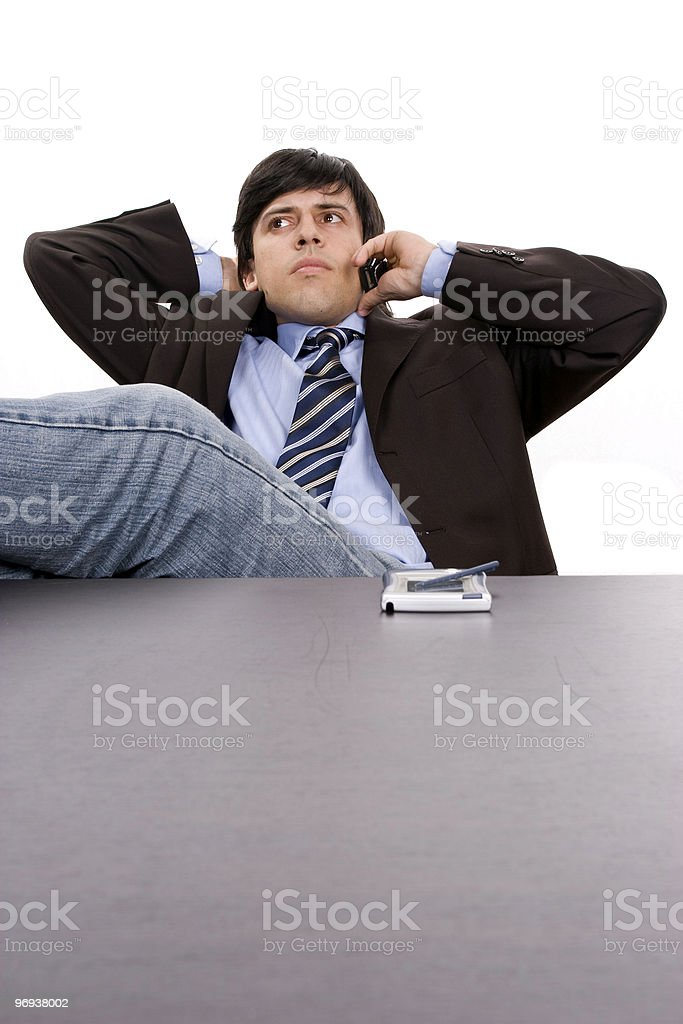 Young Businessman relaxing on the phone royalty-free stock photo