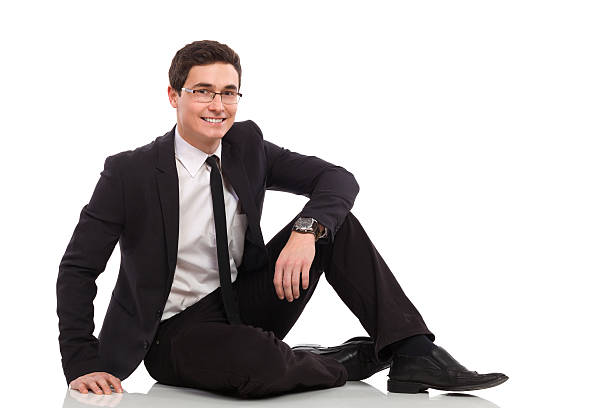 young businessman relaxing. - sitting on floor stock photos and pictures
