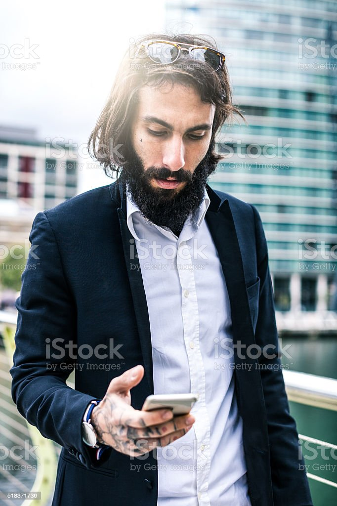 Young businessman replying on messages on mobile stock photo