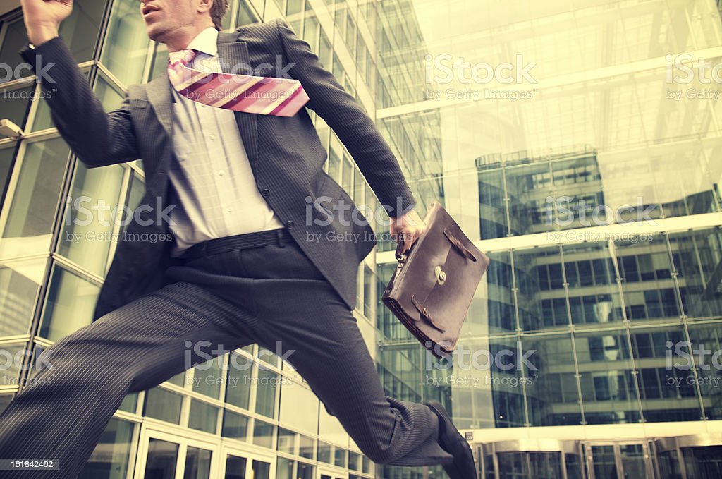 Young Businessman Running Outdoors Modern Office Building stock photo