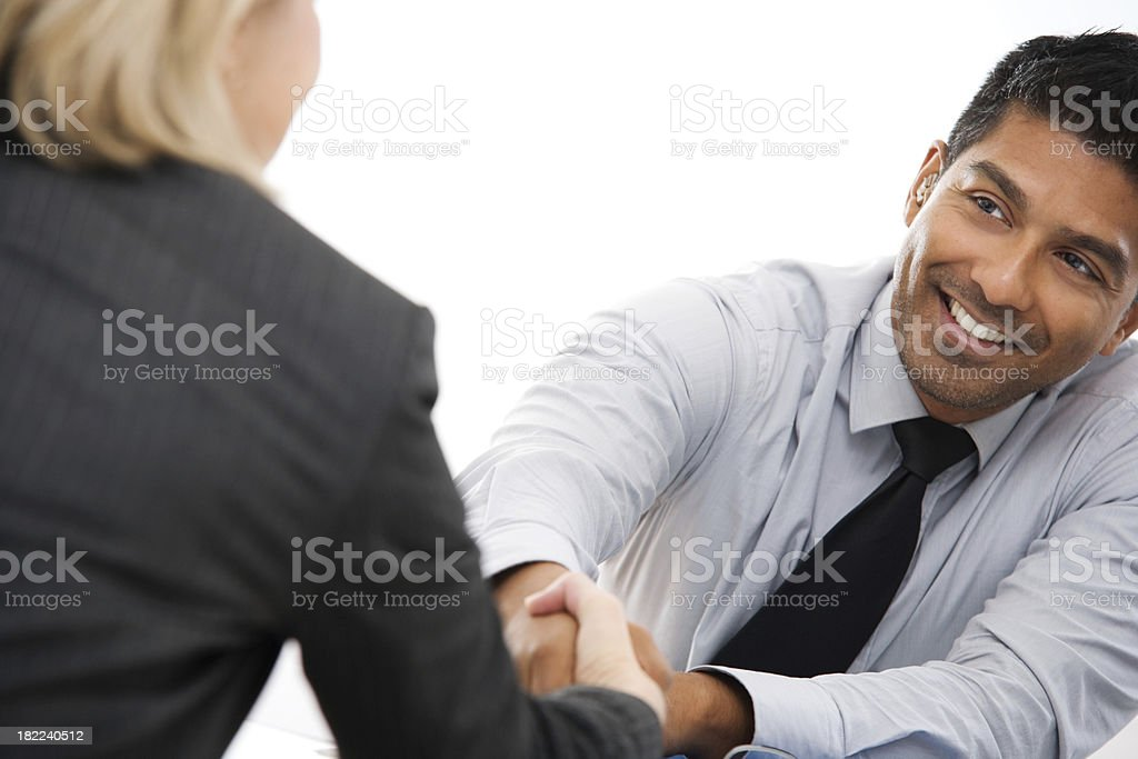 Young Businessman Shaking Hands with Female Client royalty-free stock photo