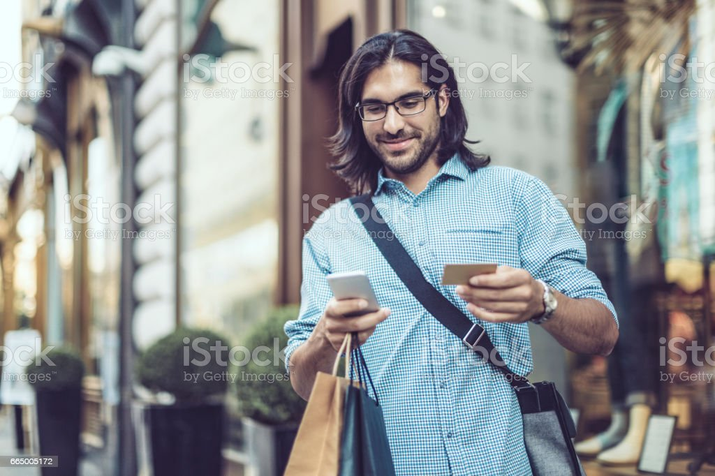 Young businessman shopping in the city stock photo