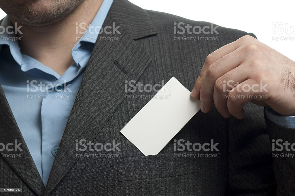 Young businessman  showed his business card isolated on white royalty-free stock photo