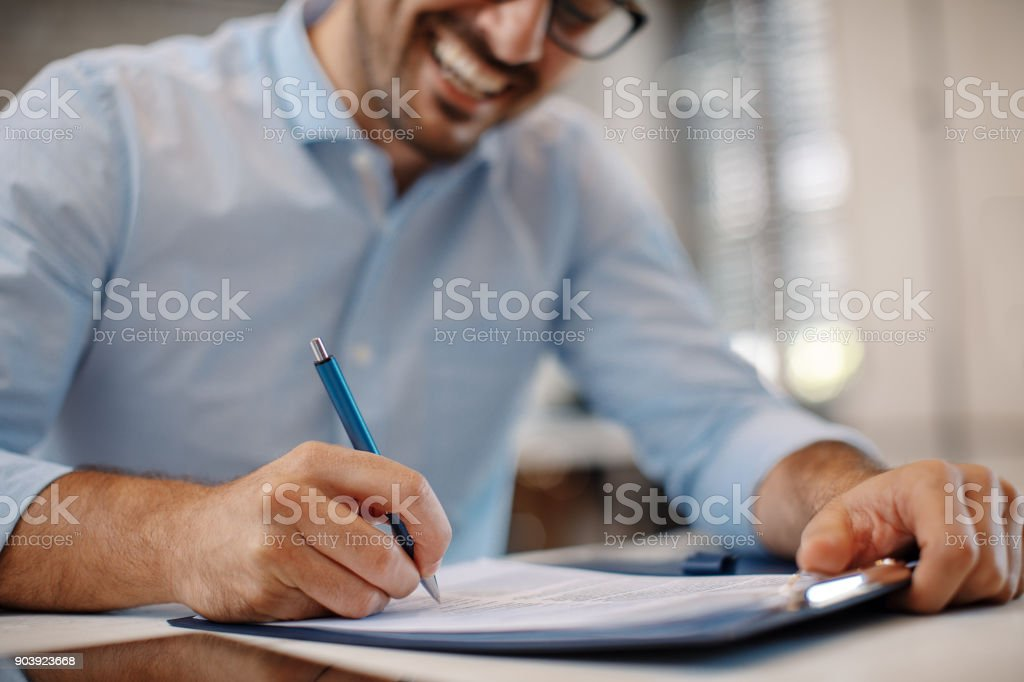 Young businessman signing a contract stock photo