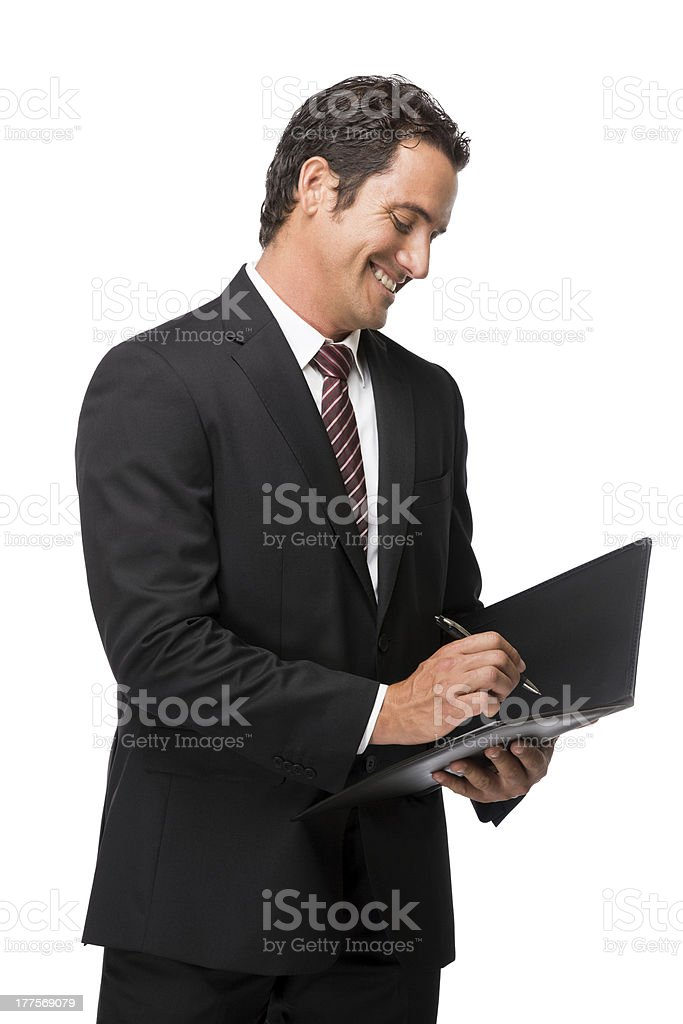Young businessman signing a file royalty-free stock photo