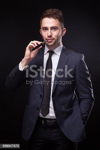 689660424 istock photo young businessman  smoke electronic cigarette 539347570