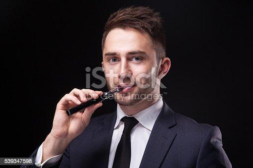 689660424 istock photo young businessman  smoke electronic cigarette 539347598
