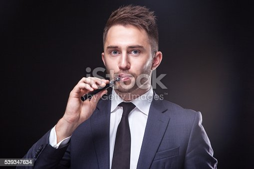 689660424 istock photo young businessman  smoke electronic cigarette 539347634