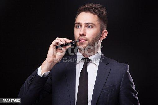 689660424 istock photo young businessman  smoke electronic cigarette 539347660