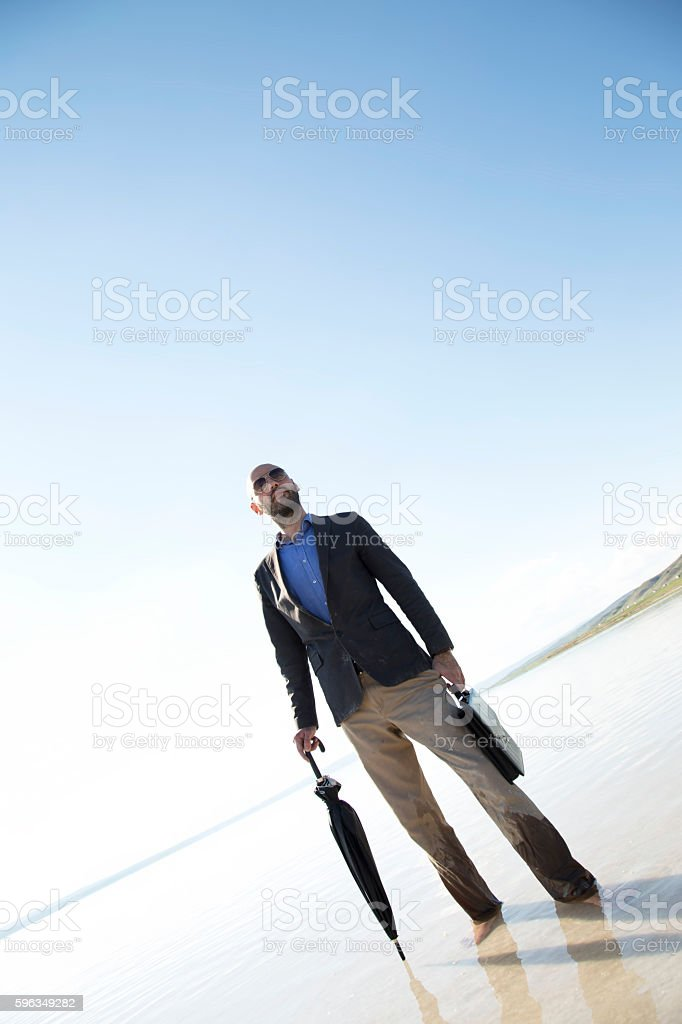 Young businessman standing against sunset. royalty-free stock photo