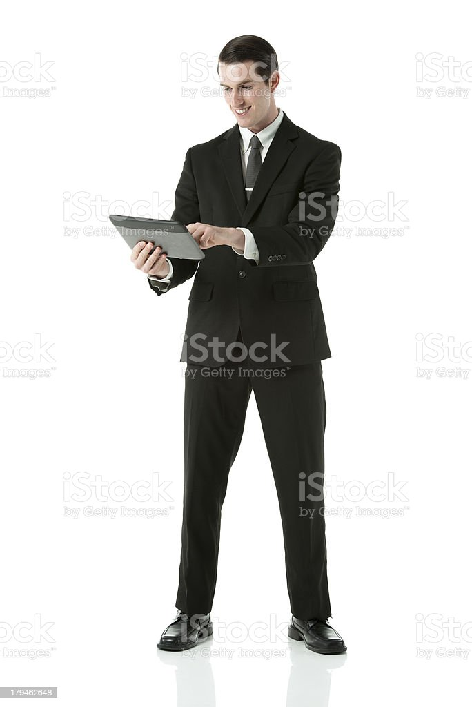 Young businessman standing with digital tablet royalty-free stock photo