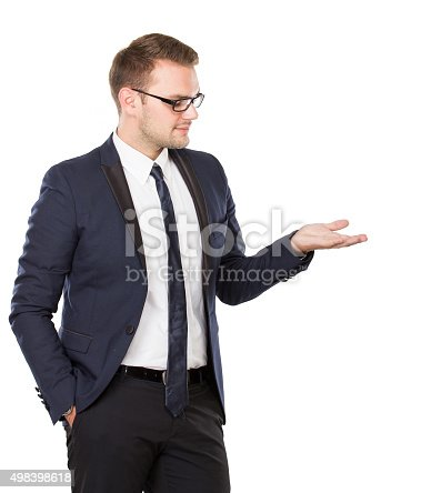 498403166 istock photo Young businessman take something on his hand, concept isolated 498398618