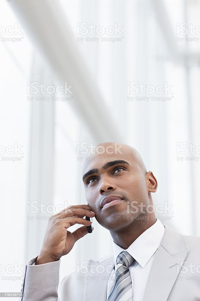 Young businessman talking on a cellphone royalty-free stock photo
