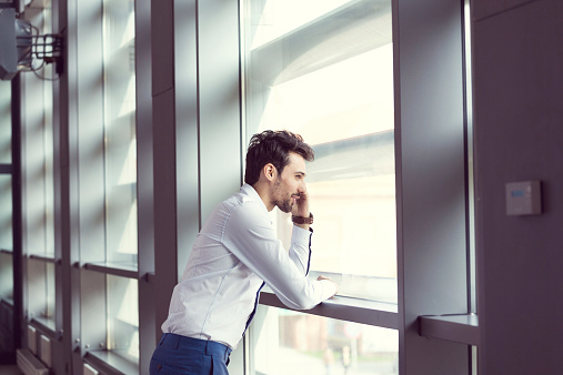 Young Businessman Talking On Cell Phone Stock Photo - Download Image Now
