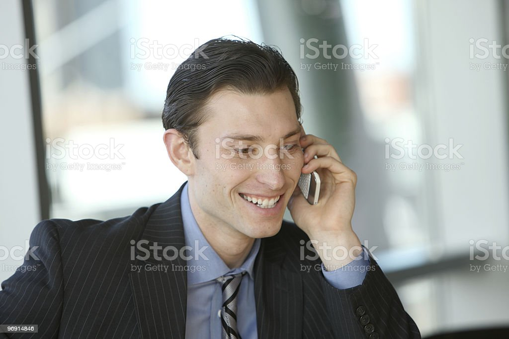 Young businessman talking on cell phone royalty-free stock photo