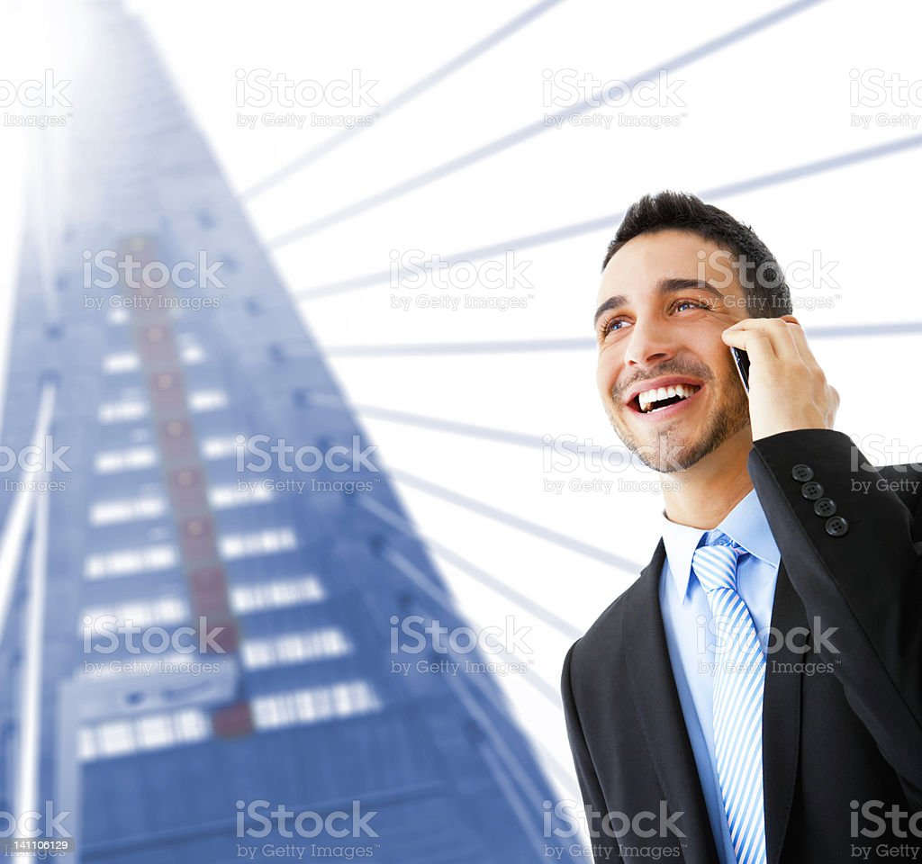 Young businessman talking on cellphone royalty-free stock photo