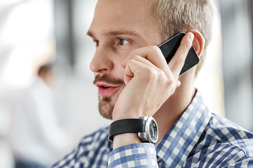 Young Businessman Talking On Mobile Phone Stock Photo - Download Image Now