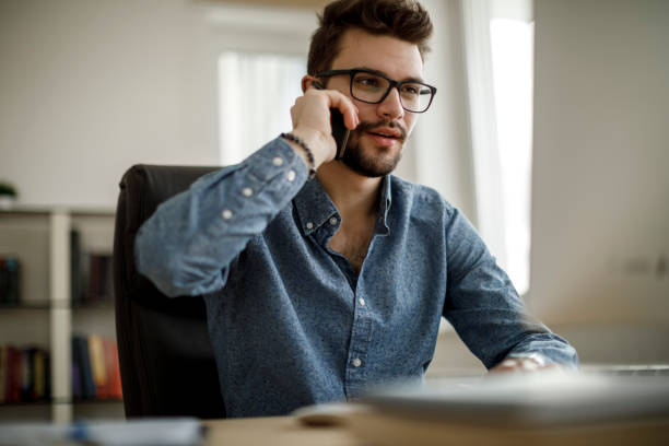 Young businessman talking on the phone stock photo
